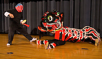 A man acts out a demonstration with a puppet during a Chinese New Year Celebration at UNC Charlotte in Charlotte, NC.
