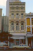 New Orleans:  622 Canal St., W.A. Freret, Architect, 1859. Old Merchants Mutual Insurance Building--twisted barley columns on 2nd floor, bulls-eye windows on top floor, and Solomonic columns.