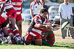 Augustine Pulu passes back ingoal to Baden Kerr as Karaka defend their line. Counties Manukau Premier Club Rugby game bewtween Waiuk & Karaka played at Waiuku on Saturday April 11th, 2010..Karaka won the game 24 - 22 after leading 21 - 9 at halftime.