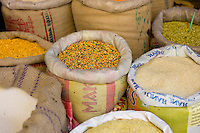 Spices and pulses including lentils and rice on sale in old town market Udaipur, Rajasthan, Western India,