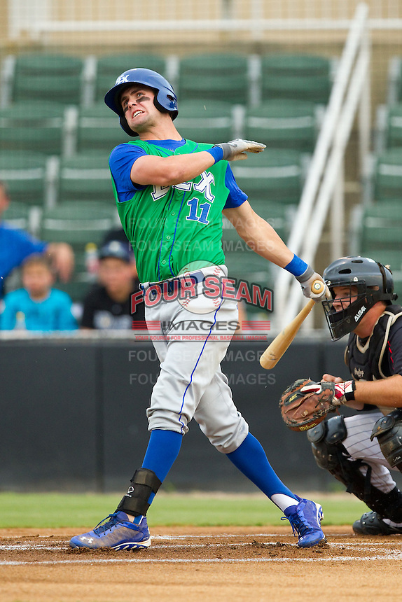Bubba Starling (11) of the Lexington Legends follows through on his swing against the Kannapolis Intimidators at CMC-Northeast Stadium on July 30, 2013 in Kannapolis, North Carolina.  The Legends defeated the Intimidators 1-0.  (Brian Westerholt/Four Seam Images)