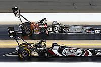 Sep 15, 2013; Charlotte, NC, USA; NHRA top fuel dragster driver Bob Vandergriff Jr (far) defeats Shawn Langdon during the Carolina Nationals at zMax Dragway. Mandatory Credit: Mark J. Rebilas-