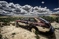 An abandoned car left to rust away in the sand near the ruins of a ranch at the entrance to the Empedrado Wilderness Study Area in the San Juan Basin of northwestern New Mexico.