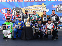 Sept. 14, 2012; Concord, NC, USA: NHRA funny car drivers (front row from left) Jack Beckman , Ron Capps , Robert Hight , Mike Neff (back row from left) Johnny Gray , Courtney Force , Cruz Pedregon , John Force , Jeff Arend and Tim Wilkerson pose for a group shot with the championship trophy during qualifying for the O'Reilly Auto Parts Nationals at zMax Dragway. Mandatory Credit: Mark J. Rebilas-