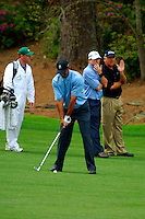 Masters Golf Tournament 2005, Augusta National Georgia, USA. Tiger Woods starting his back swing on the second shot on the 13th hole, Azalea. <br /> <br /> Champion 2005 - Tiger Woods <br /> <br /> Note: There is no property release or model release available for this image.