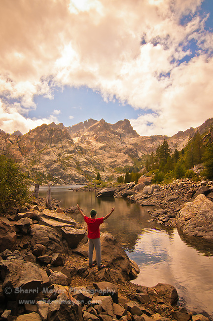 Hiker enjoying the Sierra Buttes and Upper Sardine Lake, Sierra County, Northern California.
