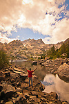 Hiker enjoying the Sierra Buttes and Upper Sardine Lake, Sierra County, Northern California.