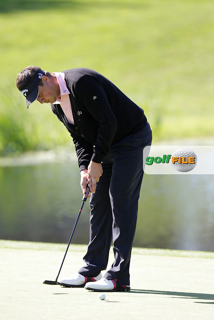 Sam Walker (ENG) putts on the 4th green during Thursday's Round 1 of the 2014 Open de Espana held at the PGA Catalunya Resort, Girona, Spain. Wednesday 15th May 2014.<br /> Picture: Eoin Clarke www.golffile.ie