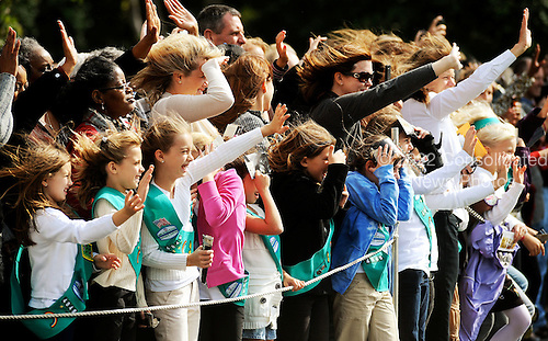 Guests wave to United States President Barack Obama as he departs the White House en route to Delaware to attend an event for Senate candidate Chris Coons, Friday, October 15 2010 at the White House in Washington DC..Credit: Olivier Douliery / Pool via CNP