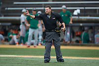 Home plate umpire Jonathan Merry indicates there are two warm-up pitches left between innings of the ACC baseball game between the Miami Hurricanes and the Wake Forest Demon Deacons at David F. Couch Ballpark on May 11, 2019 in  Winston-Salem, North Carolina. The Hurricanes defeated the Demon Deacons 8-4. (Brian Westerholt/Four Seam Images)