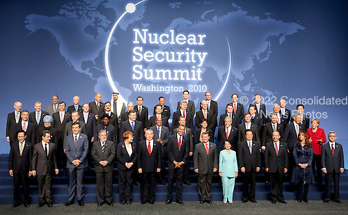 United States President Barack Obama, bottom center, poses for a group photo with the heads of delegations attending the Nuclear Security Summit at the Washington Convention Center in Washington, D.C., U.S., on Tuesday, April 13, 2010. Ukraine's agreement to relinquish its entire stockpile of highly enriched uranium gave Obama the first concrete result for a summit he convened on securing the world's atomic material. .Credit: Andrew Harrer / Pool via CNP