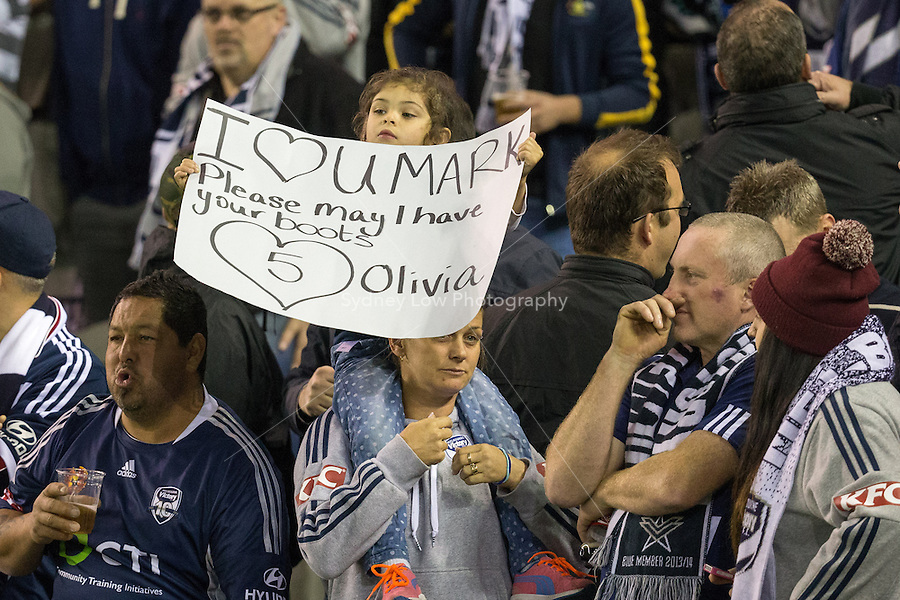 A fan holds up a sign for Melbourne Victory captain Mark Milligan in the semi final match between Melbourne Victory and Melbourne City in the Australian Hyundai A-League 2015 season at Etihad Stadium, Melbourne, Australia.<br />