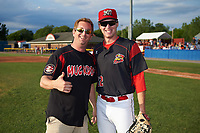 Batavia Muckdogs relief pitcher Travis Neubeck (22) poses for a photo with Tim Allen, owner of WNY Skydiving, after the ceremonial first pitch before a game against the Auburn Doubledays on June 19, 2017 at Dwyer Stadium in Batavia, New York.  Batavia defeated Auburn 8-2 in both teams opening game of the season.  (Mike Janes/Four Seam Images)