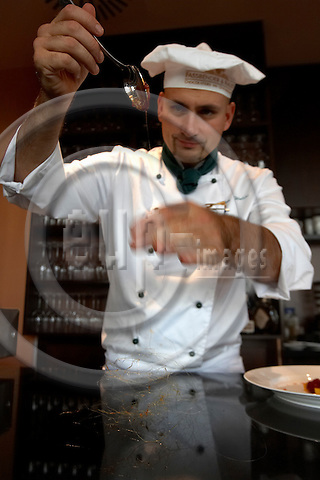 """BERLIN - GERMANY 10. OCTOBER 2006 -- Europest first Chocolate Restaurant """"Fassbender & Rausch"""" at Gendarmen Square in Berlin - Chef  Markus Walder making a caramel creation for the desert Chocolate Lasagne -- PHOTO: CHRISTIAN T. JOERGENSEN / EUP & IMAGES..This image is delivered according to terms set out in """"Terms - Prices & Terms"""". (Please see www.eup-images.com for more details)"""