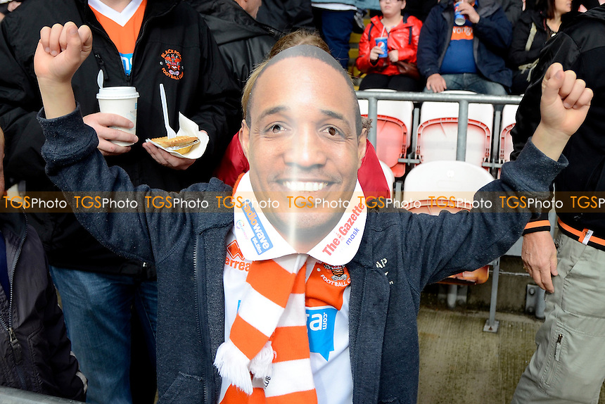 Blackpool fans wear Paul Ince face masks - Blackpool vs Wigan Athletic - Sky Bet Championship Football at Bloomfield Road, Blackpool, Lancashire - 19/10/13 - MANDATORY CREDIT: Greig Bertram/TGSPHOTO - Self billing applies where appropriate - 0845 094 6026 - contact@tgsphoto.co.uk - NO UNPAID USE