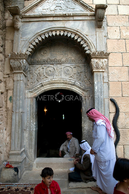 LALISH VALLEY, IRAQ: Yezidis enter the Lalish Temple...The Yezidis, a minority religious group found in northern Iraq, celebrate Chwar Shema Sur (Red Thursday), as part of their New Year festival.  The Yezidis are the religious descendants of Zoroastrians and as a religious minority in Iraq are often targeted by terrorists.