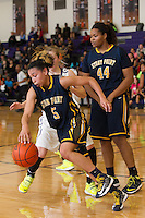 Stony Point senior guard Autumn Avina attempts to drive around Cedar Ridge's Melina Merritt Saturday at Cedar Ridge Gym.  The Raiders beat the Tigers 66-58.  (LOURDES M SHOAF for Round Rock Leader.)