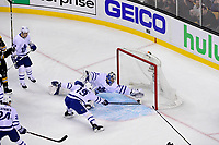 April 25, 2018: Toronto Maple Leafs center Tomas Plekanec (19) slows the puck as goaltender Frederik Andersen (31) makes a diving save during game seven of the first round of the National Hockey League's Eastern Conference Stanley Cup playoffs between the Toronto Maple Leafs and the Boston Bruins held at TD Garden, in Boston, Mass. Boston defeats Toronto 7-4 and wins the best of seven series 4 games to 3 to advance to round two.