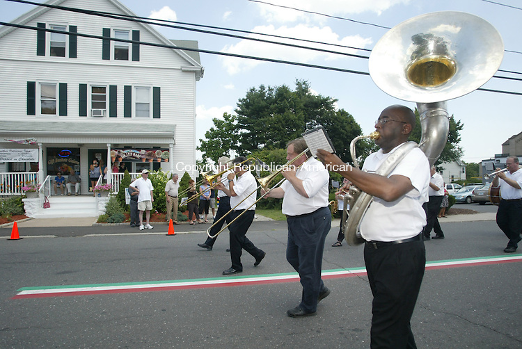 WATERBURY CT 18  JULY, 2010-071810JW07- Members of the Fulton American Band march down Highland Ave. as part of the Our Lady of Mount Carmel Church 72nd church processional through the community.<br /> Jonathan Wilcox Republican-American