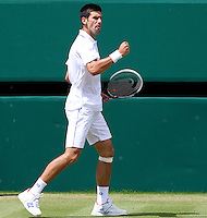 NOVAK DJOKOVIC (SRB) (2) against JO-WILFRED TSONGA (FRA) (12) in the Semi-Finals of the Gentlemen's Singles. Novak Djokovic beat Jo-Wilfred Tsonga 7-6 6-2 6-7 6-3..Tennis - Grand Slam - Wimbledon - AELTC - London- Day 11 - Fri July 1st 2011..© AMN Images, Barry House, 20-22 Worple Road, London, SW19 4DH, UK..+44 208 947 0100.www.amnimages.photoshelter.com.www.advantagemedianetwork.com.