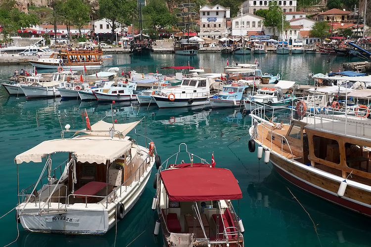 A perfectly sized harbor for small boats provides a pleasant photographic scene in the coastal city of Antalya.