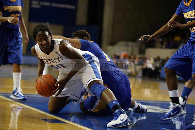 Brittany Henderson grabs a lose ball in the first regular season game play against Morehead State University at Memorial Coliseum on November 12, 2010. Photo by Ryan Buckler | Staff