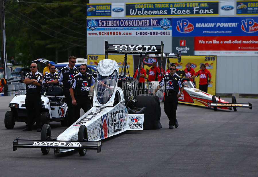 Jun 6, 2016; Epping , NH, USA; NHRA top fuel driver Antron Brown with crew members during the New England Nationals at New England Dragway. Mandatory Credit: Mark J. Rebilas-USA TODAY Sports