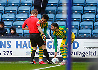 9th February 2020; The Den, London, England; English Championship Football, Millwall versus West Bromwich Albion; Linesmen assisting with placing the ball in the corner spot for Filip Krovinovic and Matheus Pereira of West Bromwich Albion during heavy wind