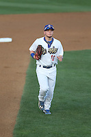 Alex Verdugo (16) of the Rancho Cucamonga Quakes returns to the dugout during a game against the High Desert Mavericks at LoanMart Field on August 18, 2015 in Rancho Cucamonga, California. High Desert defeated Rancho Cucamonga, 4-0. (Larry Goren/Four Seam Images)