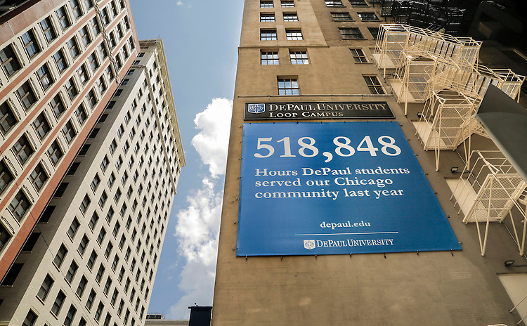 A large banner highlighting the number of community service hours DePaul University students gave to the Chicago area last year hangs near the entrance of the DePaul Center on the Loop Campus in downtown Chicago. (DePaul University/Jamie Moncrief)