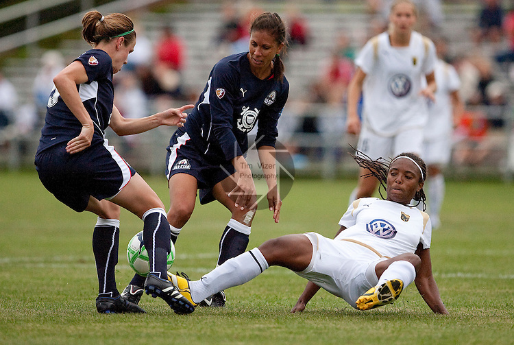 August 30 2009    WPS All Star player Shannon Boxx (7, center) flattened Swedish Umeå IK playerElaine Moura (20, right) after the two had fought wildly for possession of the ball in the second half.    At far left is WPS teammate Heather O'Reilly (9) who joined in the fracas in the second half.  The Women's Professional Soccer league held their inaugural All Star Game on August 30, 2009 at the Anheuser Busch Soccer Park in Fenton, Missouri.  The Swedish women's professional soccer team Umeå IK competed against the WPS All Stars.  The WPS All Stars won the game, 4-2. ..            *******EDITORIAL USE ONLY*******