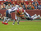 New England Patriots cornerback Jonathan Jones (31) and defensive end Deatrich Wise (91) knock the ball out of the arms of Washington Redskins wide receiver Trey Quinn (18) during the second quarter of the game at FedEx Field in Landover, Maryland on Sunday, October 6, 2019.  The Patriots recovered the fumble.  The Patriots won the game 33 - 7.<br /> Credit: Ron Sachs / CNP