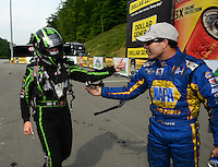Jun. 17, 2012; Bristol, TN, USA: NHRA funny car driver Alexis DeJoria (left) congratulates Ron Capps after he won the Thunder Valley Nationals at Bristol Dragway. Mandatory Credit: Mark J. Rebilas-