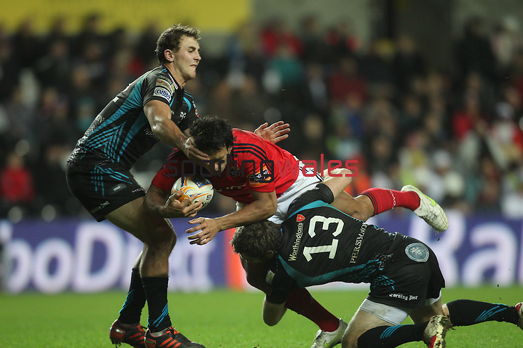 Ashley Beck and Andrew Bishop stop Conor Murray..RaboDirect Pro12.Ospreys v Munster.Liberty Stadium.03.12.11.©Steve Pope