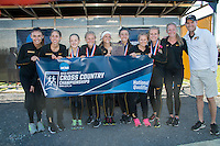 Missouri's women's cross country team pose during the awards ceremony after winning the NCAA Division I Cross Country Midwest Regional in Iowa City, Ia. Friday November 11, 2016. The win was the first victory at the meet for the program since 2003, and qualiifed them for the NCAA Championship meet for the first time since 2004.
