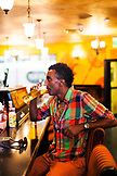 BERMUDA, Hamilton. Chef Marcus Samuelsson watching soccerand  having a beer at Flanagan's Bar in downtown Hamilton.