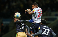 Bolton Wanderers' Josh Magennis competing with Sheffield Wednesday's Rolando Aarons and Dominic Iorfa<br /> <br /> Photographer Andrew Kearns/CameraSport<br /> <br /> The EFL Sky Bet Championship - Bolton Wanderers v Sheffield Wednesday - Tuesday 12th March 2019 - University of Bolton Stadium - Bolton<br /> <br /> World Copyright © 2019 CameraSport. All rights reserved. 43 Linden Ave. Countesthorpe. Leicester. England. LE8 5PG - Tel: +44 (0) 116 277 4147 - admin@camerasport.com - www.camerasport.com