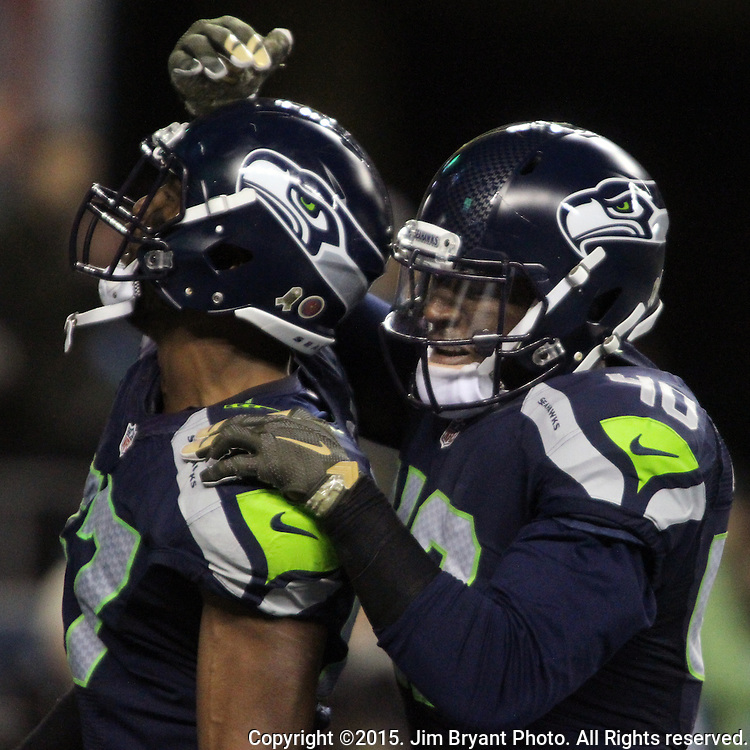Seattle Seahawks fullback Derrick Coleman celebrates with  linebacker Mike Morgan (57) celebrates after tackling Arizona Cardinals David Johnson (31) during a kickoff at CenturyLink Field in Seattle, Washington on November 15, 2015. The Cardinals beat the Seahawks 39-32.   ©2015. Jim Bryant photo. All Rights Reserved.