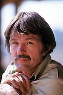 Vassouras, district of Rio de Janeiro, Brazil. 1981.  A family in Africa is besieged by a group of lions, driven mad by the drought. They have to survive multiple attacks but some of their colleagues are eaten by the lions. From the film Savage Harvest, directed by Robert E. Collins. Photo of Tom Skerritt, he has the leading role.