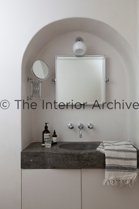 A stone wash basin has been built into this alcove in the bathroom