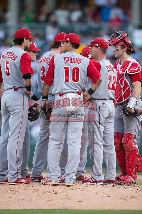 North Carolina State Wolfpack assistant coach Scott Foxhall (22) has a meeting on the mound during the game against the Charlotte 49ers at BB&T Ballpark on March 31, 2015 in Charlotte, North Carolina.  The Wolfpack defeated the 49ers 10-6.  (Brian Westerholt/Four Seam Images)
