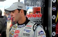 Oct. 2, 2009; Kansas City, KS, USA; Nascar Sprint Cup Series driver Jimmie Johnson during qualifying for the Price Chopper 400 at Kansas Speedway. Mandatory Credit: Mark J. Rebilas-