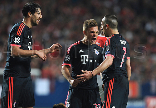13.04.2016. Lisbon, Portugal.  Munich's Javi Martinez, Joshua Kimmich and Franck Ribery (L-R) celebrate scoring the equalizing goal during the UEFA Champions League quarterfinal second leg soccer match between SL Benfica and FC Bayern Munich at Estadio da Luz in Lisbon, Portugal, 13 April 2016.