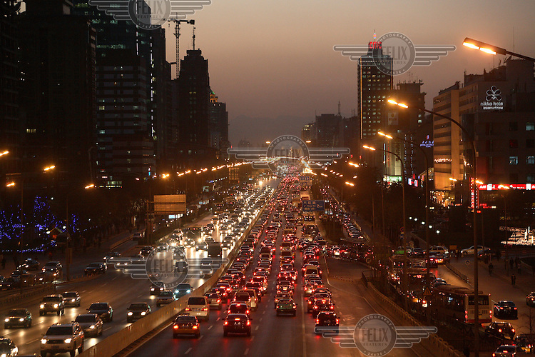 View of a crowded street during rush hour in the office district of Guomao...