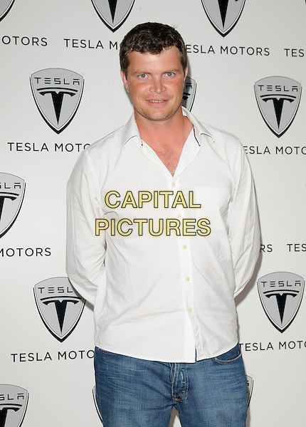 JACK KIDD.The Tesla UK launch party, Tesla Motors Ltd., Cheval Place, London, England..June 25th, 2009.half length white shirt .CAP/CAN.©Can Nguyen/Capital Pictures.