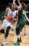 SIOUX FALLS, SD - MARCH 8: Jordan Gilbert #22 of Oral Roberts looks to shoot against defender Marena Whittle #32 of North Dakota State in the first half of their first round Summit League Championship Tournament game Sunday afternoon at the Denny Sanford Premier Center in Sioux Falls, SD. (Photo by Dick Carlson/Inertia)