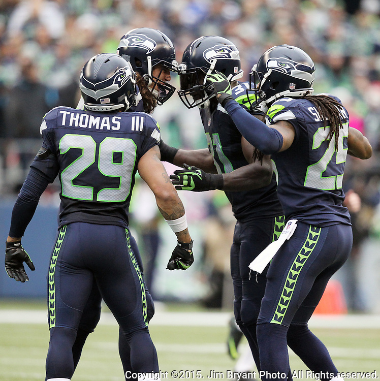 Seattle Seahawks  defenders Luke Willson, Earl Thomas, Richard Sherman and Kam Chancellor celebrate after forcing the Carolina Panthers  to turn the ball over on downs at CenturyLink Field in Seattle on October 18, 2015. The Panthers came from behind with 32 seconds remaining in the 4th Quarter to beat the Seahawks 27-23.  ©2015 Jim Bryant Photography. All Rights Reserved.