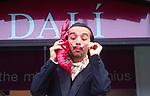 ATBK5F Salvador Dali impersonator holding red lobster phone