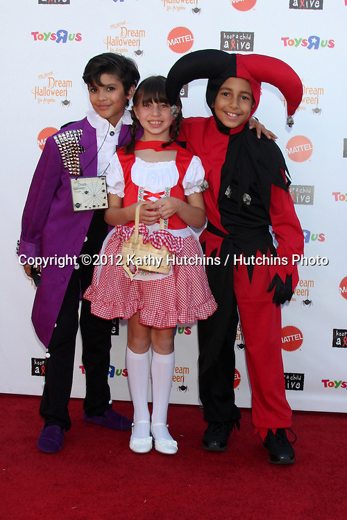 "LOS ANGELES - OCT 27:  Xolo Mariduena, Savannah Paige Rae, Tyree Brown arrives at ""Keep A Child Alive Presents 2012 Dream Halloween Los Angeles"" at Barker Hanger on October 27, 2012 in Santa Monica, CA"