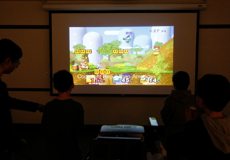 "Southbury, CT-06 March 2012-030612CM02-  COUNTRY LIFE ONLY PLEASE  Children play ""Super Smash Bros"" during ""Wii Have Fun"" event Tuesday afternoon at the Southbury Library. The event which features Wii, board games and snacks is expected to be held every month at the library said Joan Stokes, children's librarian.  She said it's a program for the kids to have fun in a safe controlled environment.   Christopher Massa Republican-American"